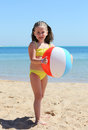 Happy little girl with ball on beach inflatable Stock Photo
