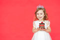 Happy little girl with birthday cake isolated on red background Royalty Free Stock Photo