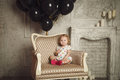 Happy little girl with black balloons stock photo in studio Stock Image