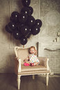 Happy little girl with black balloons stock photo in studio Royalty Free Stock Photos