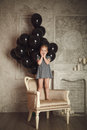 Happy little girl with black balloons stock photo in studio Royalty Free Stock Photo