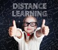 Happy little girl on blackboard background with math and art pattern. Distance learning and creativity education concept Royalty Free Stock Photo