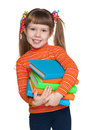 Happy little girl with books a portrait of a cheerful against the white background Royalty Free Stock Photo