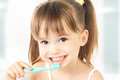 Happy little girl brushing her teeth dental hygiene Royalty Free Stock Photo