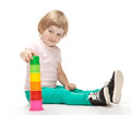 Happy little girl building toy pyramid Royalty Free Stock Photography