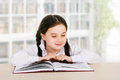 Happy little girl child reads book indoor Royalty Free Stock Photo