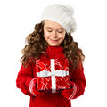 Happy little girl with Christmas gift on isolated white background