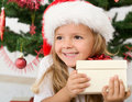 Happy little girl with christmas present Royalty Free Stock Photo