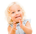 Happy little girl clapping isolated over a white background Royalty Free Stock Images