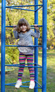 Happy little girl climb park playground Stock Photos