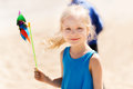 Happy little girl with colorful pinwheel at summer Royalty Free Stock Photo