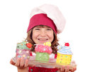 Happy little girl cook with cupcakes sweet Royalty Free Stock Image
