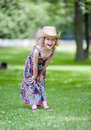 Happy little girl in cowboy hat standing grass Royalty Free Stock Photos