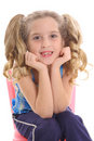 Happy little girl with curly pig tails Stock Photo