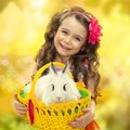 Happy little girl with easter rabbit in basket greeting card Royalty Free Stock Photography