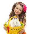 Happy little girl with easter rabbit in basket greeting card isolated on white background Stock Image