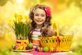 Happy little girl with easter rabbit and eggs in basket greeting card Stock Images