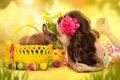Happy little girl with easter rabbit and eggs in basket greeting card Royalty Free Stock Photography