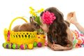 Happy little girl with easter rabbit and eggs in basket greeting card isolated on white background Stock Photo