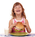 Happy little girl eat big sandwich breakfast time Stock Photography