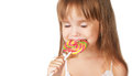 Happy little girl eating a lollipop candy Royalty Free Stock Photo