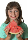 Happy little girl eating melon Royalty Free Stock Photo