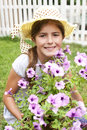 Happy little girl with flowers children cheerful florist Stock Images
