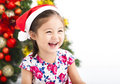 Happy little girl in front of christmas tree Royalty Free Stock Photo