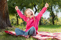 Happy little girl with hands up Stock Image