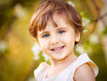 Happy little girl having fun in the blooming spring garden smile Stock Photography