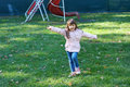 Happy little girl having fun at the park and she s dressed in a pink blouse Stock Images