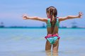 Happy little girl having fun, swimming and jumping Royalty Free Stock Photo