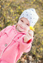 Happy little girl holding a yellow flower Royalty Free Stock Photo