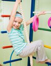 Happy little girl at home gym Stock Photos