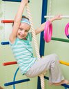 Happy little girl at home gym smiling doing sports gymnastics Stock Images