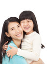 Happy little girl hugging with her mother asian Royalty Free Stock Images
