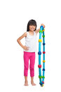 Happy little girl with hula hoop Royalty Free Stock Photo