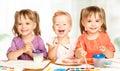 Happy little girl in kindergarten draw paints sister Royalty Free Stock Image