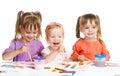 Happy little girl in kindergarten draw paints on white background