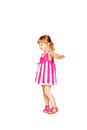 Happy little girl in knitted pink dress dancing isolated on white background Royalty Free Stock Photo