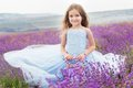 Happy little girl in lavender field with basket Royalty Free Stock Photo