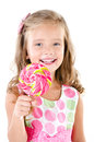 Happy little girl with lollipop isolated on a white background Royalty Free Stock Image