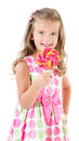 Happy little girl with lollipop isolated on a white background Stock Photos