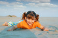 Happy little girl lying sand Royalty Free Stock Photo