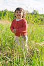 Happy little girl on meadow Stock Image