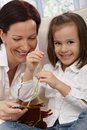 Happy little girl and mother doing needlework Royalty Free Stock Photography