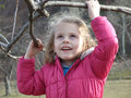 Happy little girl in the park hand holding a branch Royalty Free Stock Photography