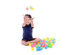 Happy little girl playing with colourful balls this image has attached release Stock Images