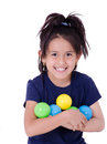 Happy little girl playing with colourful balls this image has attached release Stock Photos