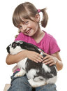 Happy little girl playing with her rabbit Stock Image